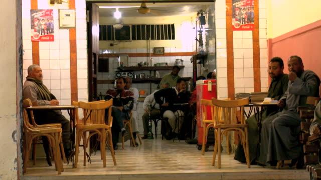 ms men sitting in cafã© at night / hurghada, red sea coast, egypt - hurghada stock-videos und b-roll-filmmaterial