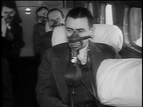 b/w 1939 ms men sitting on airplane wearing oxygen masks - protection stock videos & royalty-free footage