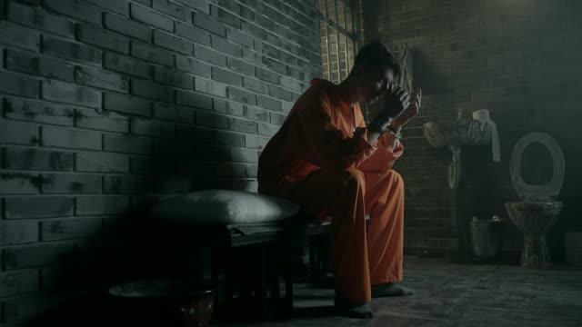 men sitting on bed in prison cell - prisoner orange stock videos & royalty-free footage