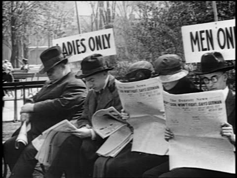 "B/W 1919 men sitting on bench marked ""Ladies only"" + reading newspapers / women try to sit down"