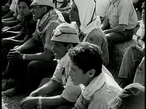 stockvideo's en b-roll-footage met b/w 1948 men sitting outdoors listening / israel /documentary - 1948