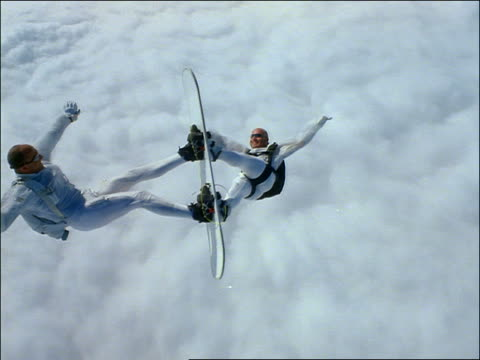aerial 2 men skysurfing over clouds with boards locked - tandem stock videos & royalty-free footage