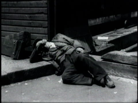 montage men sleeping on the ground during the great depression / united states - unemployment stock videos & royalty-free footage