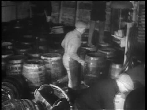 b/w 1932 men smashing barrels of beer with hammers axes / chicago - anno 1932 video stock e b–roll