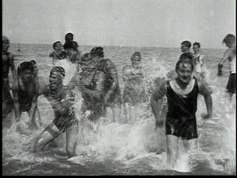 men splashing in surf / man diving off of a board on shore - 1934 stock videos & royalty-free footage