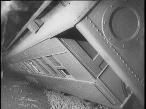 men stand on tracks at night looking at wreckage of two trains that collided / railcars laying on their sides / montage of undercarriage seats train... - flugpassagier stock-videos und b-roll-filmmaterial