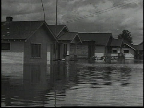 men standing around boat / flooded houses / men in boat survey flooding / workers carrying items out of flooded house / workers standing on the roof... - 1934 stock videos & royalty-free footage