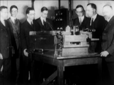 b/w 1924 men standing around machinery to send photograph to ny by wire / cleveland oh - 1924 stock videos & royalty-free footage
