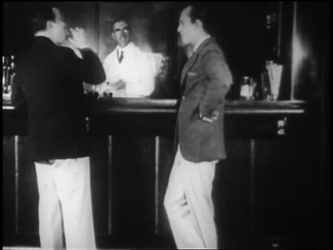 b/w 1928 2 men standing at bar drinking on ocean liner / newsreel - passenger ship stock videos & royalty-free footage