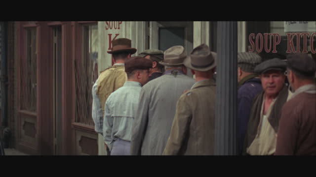 ms men standing at entrance of soup kitchen / chicago, illinois, usa - soup kitchen stock videos & royalty-free footage