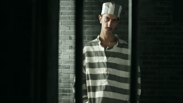 men standing at prison cell - claustrophobia stock videos and b-roll footage