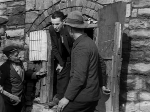 b/w 1935 3 men standing in entrance to abandoned coke oven / pennsylvania / newsreel - 1935 stock videos & royalty-free footage