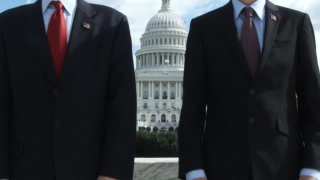 stockvideo's en b-roll-footage met  cu men standing in front of capitol building / washington, dc, usa - compleet pak