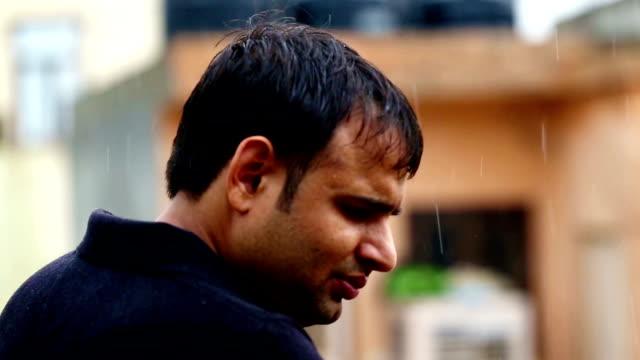men standing portrait in the rain - black shirt stock videos & royalty-free footage