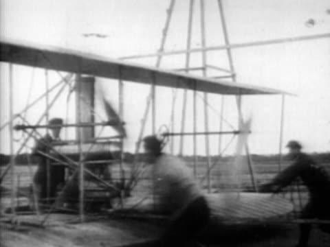 men starting propellers of bi-plane - propeller stock videos & royalty-free footage