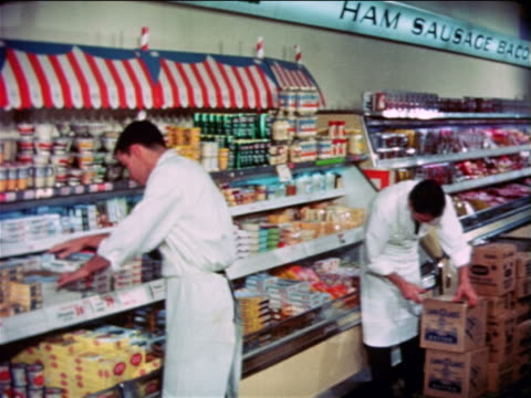 1965 men stocking shelves in grocery store / educational - shelf stock videos & royalty-free footage