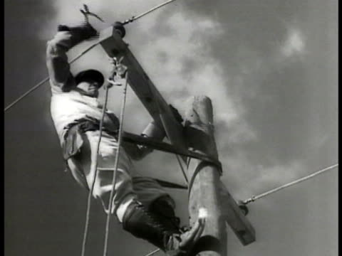 vidéos et rushes de men string electric wires into church worker on power pole men stringing wire into home man connecting exterior electric meter male working on power... - 1936