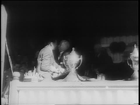 B/W 1960 men struggling after assassination attempt on Hendrik Verwoerd / South Africa / newsreel