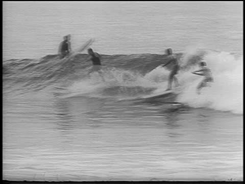 B/W 1966 PAN 3 men surfing / Hawaii / newsreel