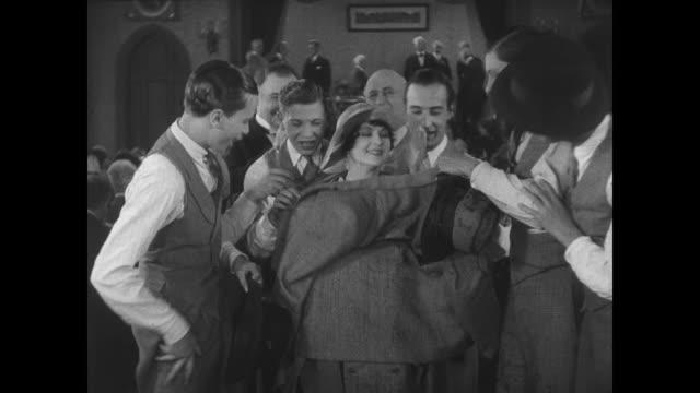 1927 men swarm around the popular girl (anne cornwall) - formelle geschäftskleidung stock-videos und b-roll-filmmaterial