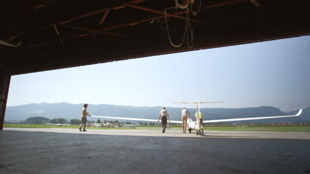 men taking a glider out of the hangar - glider stock videos & royalty-free footage
