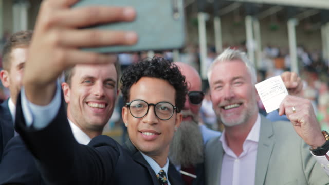 men taking a selfie - horse racing stock videos & royalty-free footage