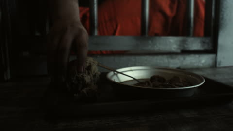 men taking food from prison floor - meal stock videos & royalty-free footage