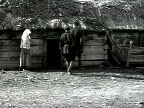 men taking grain sacks from small house, men filling up bags with grain, bags on cart audio/ russia - anno 1928 video stock e b–roll
