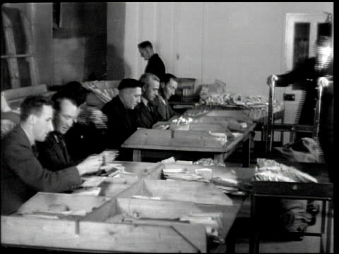 IRELAND CENSORSHIP Men taking mail bags out of van people in room sorting mail man checking postcards women checking mail woman hands resealing...