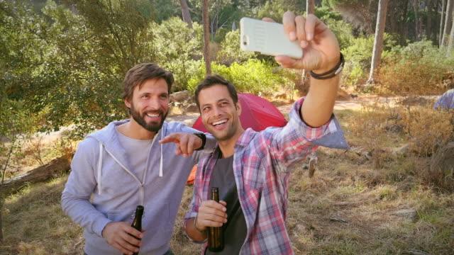 Men taking selfie with beer
