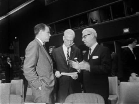 B/W 1967 3 men talking in United Nations Security Council meeting / New York City / newsreel