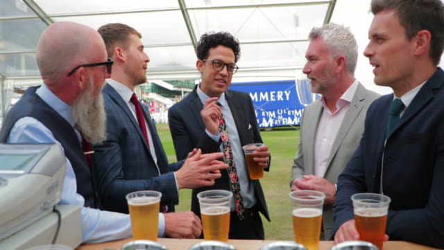 men talking over a few beers - formal reception stock videos and b-roll footage