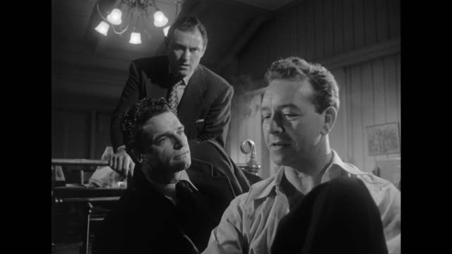 1948 men tell a restless ex-convict about their less than glamorous jobs - film noir style stock videos and b-roll footage