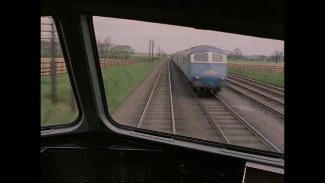 1960 - men test driving train through countryside, united kingdom - railway track stock videos & royalty-free footage