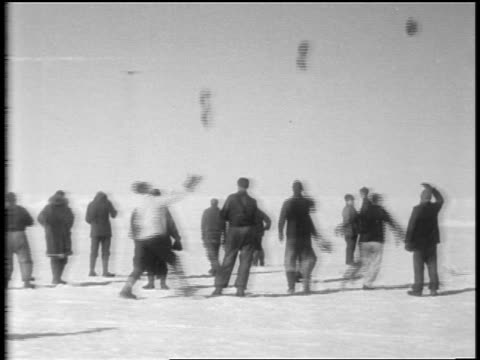 view men throw hats in air cheer as admiral byrd's airplane nears / antarctica - 1929 stock videos and b-roll footage