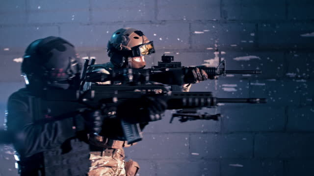 men training on a shooting range. machine guns - special forces stock videos & royalty-free footage