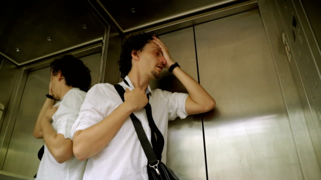 men  trapped inside elevator - terrified stock videos & royalty-free footage