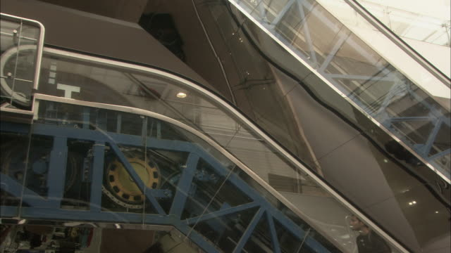 men travel up escalator in shopping centre available in hd. - machine part stock videos & royalty-free footage