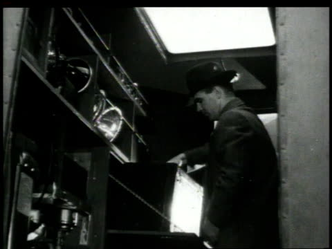 stockvideo's en b-roll-footage met 1948 montage men unloading mobile crime lab / new york city, new york, united states - 1948