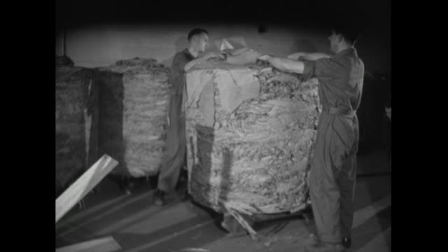 men unpack raw tobacco leaves shipment; 1951 - only mid adult men stock videos & royalty-free footage