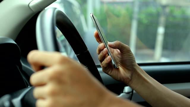 men using smartphone in car