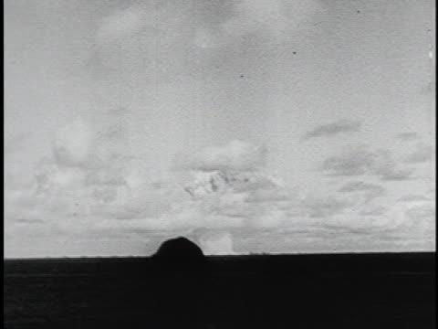 men view an atomic bomb exploding on the horizon. - atomic bomb stock videos & royalty-free footage