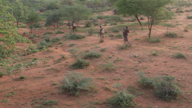Men walk across terrain