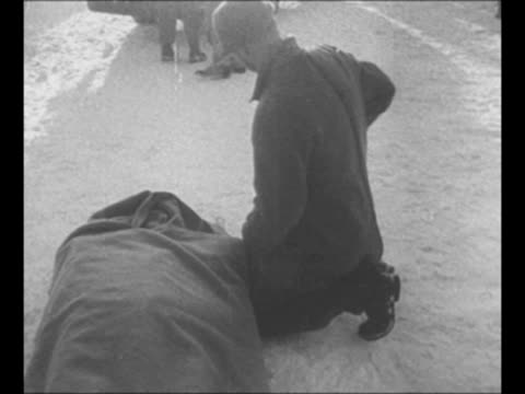 """men walk in snow near snowplow with driver inside / man with injured person in blanket-wrapped stretcher / montage stranded """"city of san francisco""""... - bahnreisender stock-videos und b-roll-filmmaterial"""