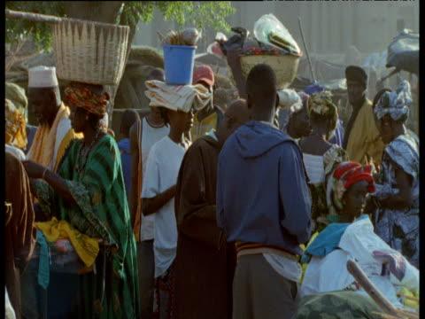 Men walk through Djenne market