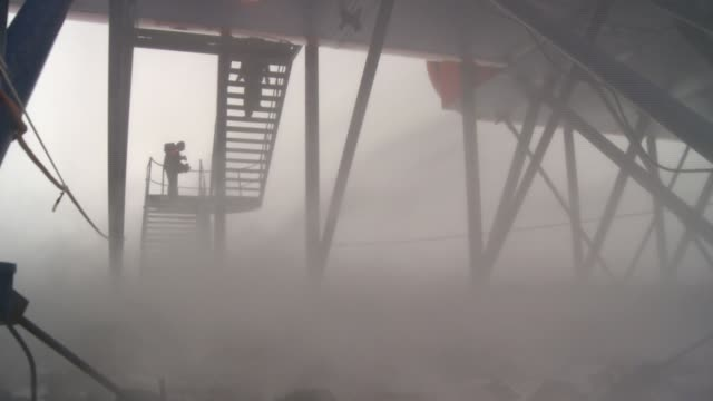 men walk up the stairs of the south african ice station during a blizzard. available in hd. - antarctica people stock videos & royalty-free footage