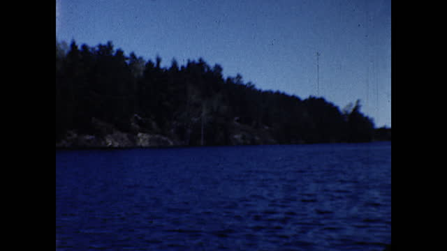 """men walking around a lake pier with a cabin in the background; little girl sitting on a chair in front of the cabin; signs next to the cabin """"office""""... - 1940 1949 stock videos & royalty-free footage"""