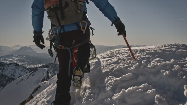 men walking on mountain ridge during winter - sports equipment stock videos & royalty-free footage