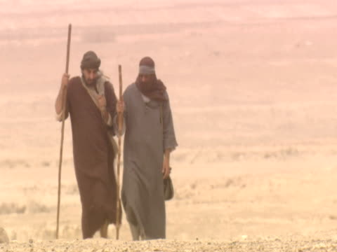 stockvideo's en b-roll-footage met men walking on road to emmaus prior to meeting jesus christ - mid volwassen mannen