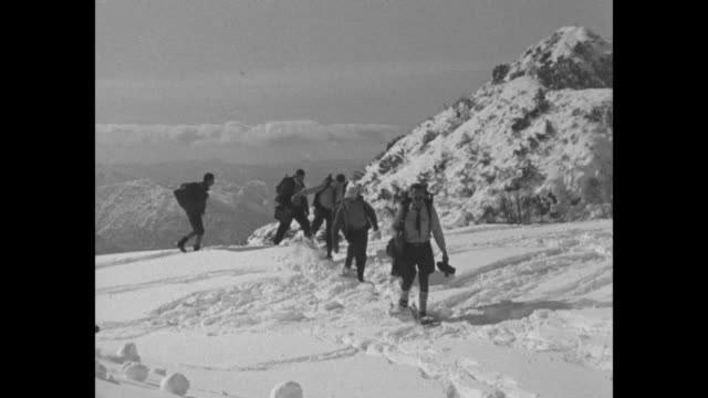 stockvideo's en b-roll-footage met men walking on snowshoes make way on mountain in sequoia national park / note exact month/day not known - sequoia national park